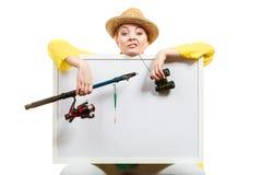 Пробуренная женщина при рыболовная удочка держа доску Стоковое Изображение
