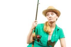 Пробуренная женщина с рыболовной удочкой, закручивая оборудованием Стоковое Изображение