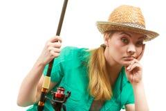 Пробуренная женщина с рыболовной удочкой, закручивая оборудованием Стоковые Изображения
