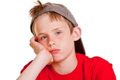Пробуренный подавленный молодой мальчик с унылыми глазами Стоковые Фото