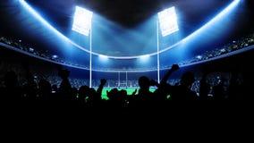 Проблескивая света стадиона во время игры