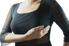 Проверка рака молочной железы само- Женщина крупного плана с проверкой рака молочной железы Стоковые Изображения