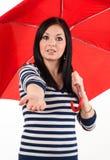Проверки маленькой девочки если оно идет дождь Стоковые Изображения