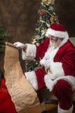 проверять его список santa Стоковые Фото