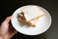 Провозглашанный тост кусок 3 на вашей руке Стоковое Фото