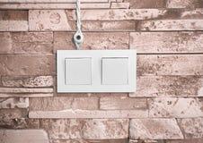 Провода и переключатель на каменной стене Стоковая Фотография RF