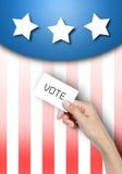 Проголосуйте карточку в руке. стоковые изображения