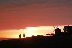 Прогулка захода солнца Стоковые Фото