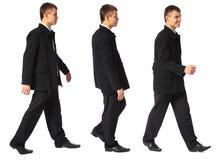 прогулки бизнесмена сь молодые Стоковые Изображения RF