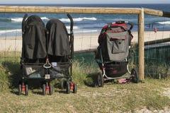 Прогулочные коляски смотря вне к морю Стоковая Фотография RF