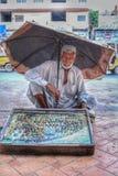 Продавец камней судьбы стоковое фото
