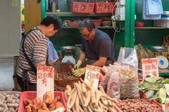Продавцы рынка корней Стоковая Фотография RF