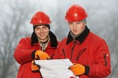 Проектирует строителей на строительной площадке Стоковое Изображение