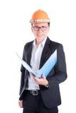 Проектируйте человека нося оранжевый шлем и черный костюм Стоковая Фотография RF