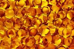 Прозрачная желтая предпосылка шариков стоковые фото