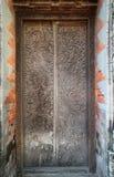 Произведение искусства высекая дверь в индусском tample Стоковое фото RF