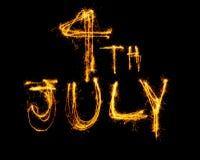 Произношение по буквам 4-ое июля Sparklers Стоковая Фотография RF