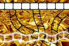 прокладка вьюрка кино пленки эры золотистая Стоковая Фотография