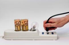 Прокладка силы с деньгами и штепсельной вилкой Стоковая Фотография RF