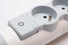 Прокладка электропитания с переключателем включеный-выключеным на белой предпосылке Стоковое фото RF
