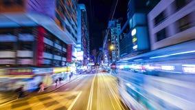 Промежуток времени двигая через современную улицу города ночи с небоскребами Hong Kong сток-видео