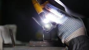 промышленное изготавливание Деталь трубки утюга Процесс заварки Нагревая процесс свет стоковое фото