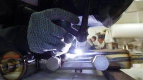 промышленное изготавливание Деталь трубы утюга Процесс заварки стоковое фото