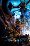 Промышленный стальной сварщик в фабрике стоковое фото rf