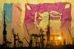 Промышленная концепция с флагом Шри-Ланки на заходе солнца стоковые изображения