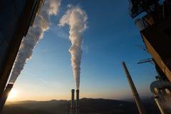 Промышленная электростанция на заходе солнца Стоковое фото RF