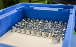 Промышленные стальные части в коробке Стоковые Изображения RF