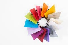 Пропеллер покрашенных конвертов на белом столе Стоковые Фотографии RF