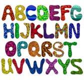 Прописные буквы алфавита смешные в цветах Иллюстрация вектора