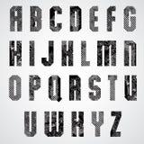 Прописные буквы Grunge черные протертые, декоративный striped шрифт дальше Стоковое фото RF