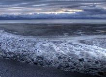 пропуская вода захода солнца приливная Стоковое Изображение RF