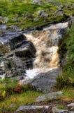 пропуская малый водопад стоковые фото
