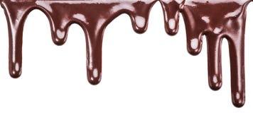 Пропуская падения шоколада или падения поливы шоколада Стоковые Изображения RF
