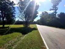 Проселочная дорога принимает меня домашний стоковое фото