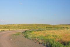 Проселочная дорога через downland Стоковые Изображения