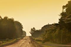Проселочная дорога в вечере Стоковые Изображения RF