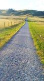 Проселочная дорога принимает меня домашний Стоковая Фотография RF
