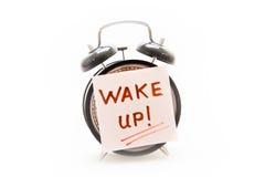 Проспите вверх по концепции звонка с примечанием будильника и прилипателя Стоковое Изображение RF