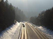 Простирание прямой дороги с загибом на заднем плане Стоковые Изображения
