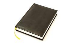 Простой черный кожаный блокнот для примечания с желтым цветом Стоковое Изображение