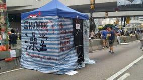 Протестующие в дороге Harcout около центрального правительства Offi занимают протесты 2014 Admirlty Гонконга революция зонтика за Стоковое фото RF