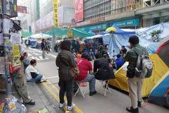 Протестующие демократии Гонконга воюют их вождь бывший Стоковое Изображение RF