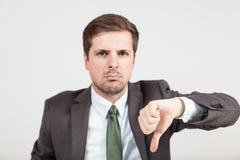 Противореча бизнесмен с thump вниз Стоковые Изображения RF