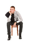 против белизны человека стула предпосылки сидя Стоковое фото RF