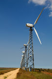 против голубого ветра неба генератора Стоковое Фото