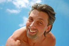 против голубого смешного неба человека Стоковое Изображение